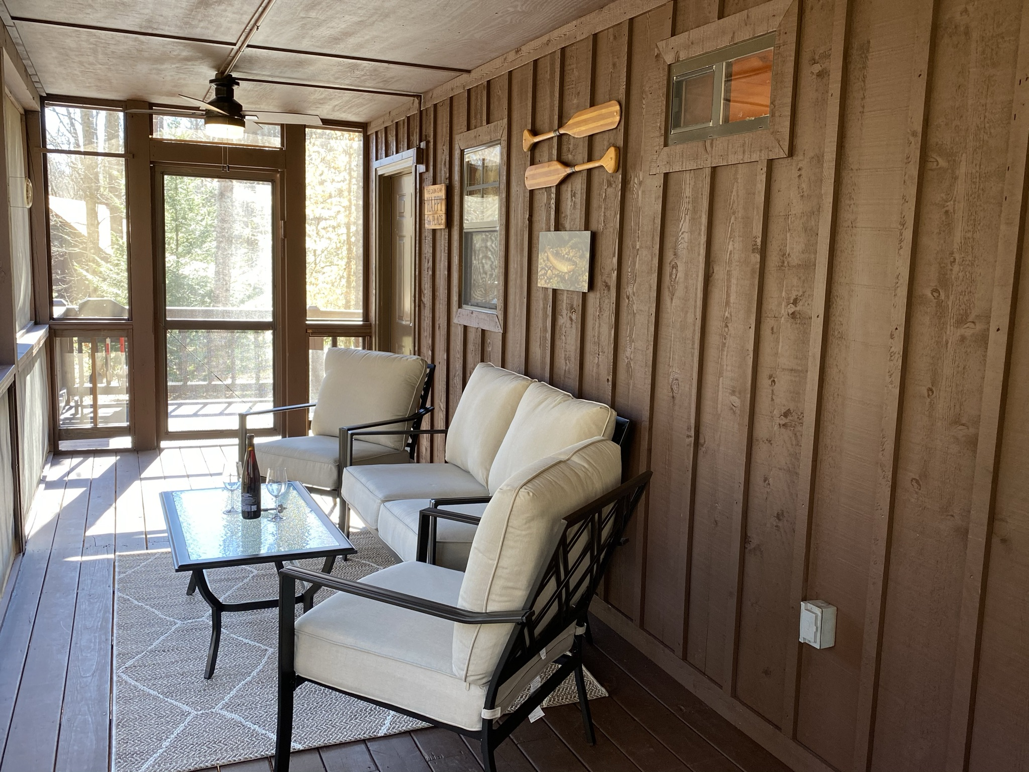 Comfortable patio furniture to enjoy the views from the screened porch